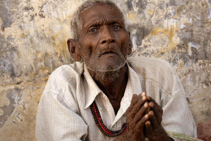 Poverty is one of the conditions of life in India. This wrinkled man was submissively trying to beg a few rupees from the neverending passing people in Uttar Pradesh's Sarnath near Varanasi. Read about the man in this story.