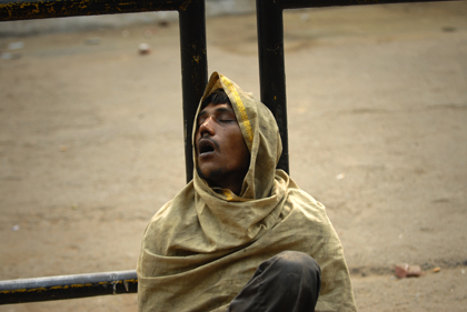 At the circle in Delhi the photographer caught this photo of a sleepy-eyed Indian man resting up against a steel fence at Connaught Place also known as Rajiv Chowk. Read about the the place between the rich and the poor in this archive story.