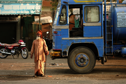 Driving between locations in the Maharashtra state the photographer met a Baba near a road wearing saffron-colored clothing in a small market town of Maharashtra. Read about Maharashtra in this archive story.